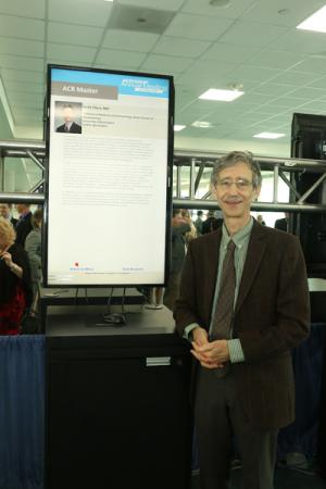 Image of Keith Elkon standing with ACR Master poster.